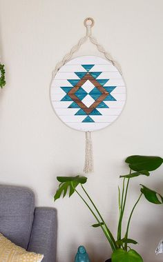 Dimensions: 16 diameter Weight: 5 lbs Individually made to order. This round wood wall art is bordered with natural, cotton rope, and incorporates bohemian macrame accents for a relaxed piece of unique artwork. A natural wood ring is installed at the top for easy