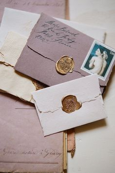 What's not to love about this image? Handmade paper, wax seal, vintage stamps, and calligraphy! All stunning!