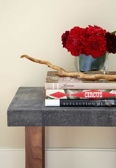 Designed by Denise McGaha Interiors. Photographed by Bill Bolin. #dallas #texas #design #interiordesign #details #flowers #floral #color #red #table #console #books #hallway