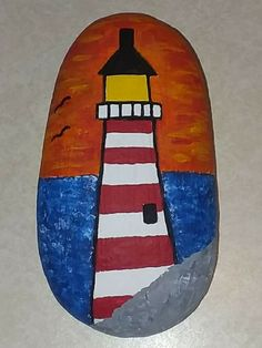 Lighthouse painted rock