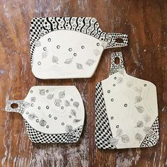 These ceramic cheese boards are made by Patricia Griffin in Cambria, Ca. Each piece is etched by hand in designs that look like woodcuts on the clay. You can see more at patriciagriffinceramics.com.