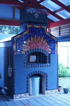 A very nice mosaic of colors on this oven. Built by Peter in Adelaide, South Australia. Foyers, Barbecue, Bread Oven, Four A Pizza, Pizza Oven Outdoor, Smoke Grill, Small Tiles, Wood Fired Oven, Mosaic Designs