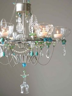 Bits and bobs chandelier: HOW incredible is this?? Looks to be made of glass teacups, saucers, wine glasses, metal jello molds and maybe a coffee maker stainer part plus beads and old jewelry! How fun is this!!!!!!!!!!!!!!!