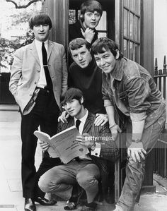 1960s: Portrait of the British rock group The Animals gathered in front of a telephone booth. Left to right: Dave Rowberry (1940 - 2003), Chas Chandler (on phone), John Steel, Eric Burdon and Hilton Valentine.