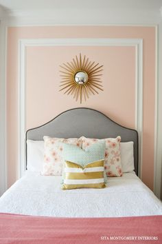 The headboard makes for a nice contrast against the pale peach/pink wall.