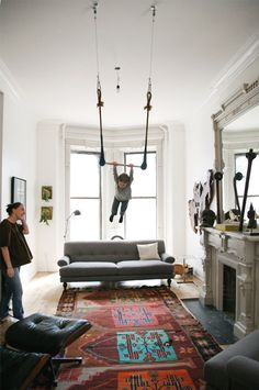 Living room flying trapeze.   I always wanted to make our chandelier into a trapeze as a kid. This is awesome