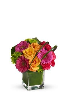 Rare Beauty by Teleflora: orange roses, hot pink minature gerberas, hot pink carnations, hot pink minature carnations and green button spray. Love the colors!
