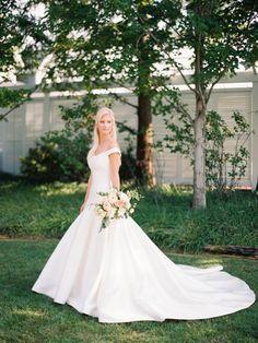 Off the shoulder stain ballgown wedding dress: http://www.stylemepretty.com/maryland-weddings/stevensville-maryland/2015/11/20/classic-romantic-wedding-at-the-chesapeake-bay-beach-club/   Photography: Krista A Jones - http://kristaajones.com/