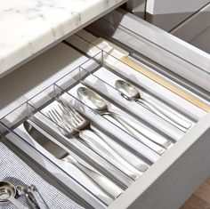 Shop Madesmart ® Clear Drawer Organizer.  Flatware, cutlery and gadgets get compartmentalized for convenience in this divided storage tray with six sections: four for flatware, with one longer section for utensils and another section for gadgets.