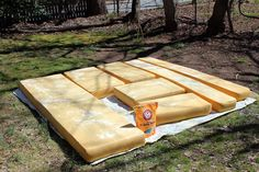 clean foam camper cushions-remove fabric covers place cushions on a clean, old sheet in full sun~ liberally sprinkle cushions with straight-up baking soda~baking soda disappears into the foam, just keep sprinkling-let them sit in the sun for a few hours~flip cushions sprinkle other side. remove baking soda by holding cushions up shaking~Fill spray bottle with water and distilled vinegar. mist cushions with vinegar water and let them sit in the sun until dry.
