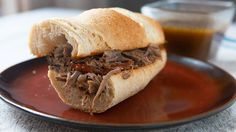 A fantastic classic French dip sandwich made with slow cooker roast beef and a simple au jus sauce.