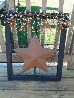 Chicken Wire Window w/ pip berry & rusty stars, I made for my sister