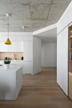 Apartment in Vilnius / Normundas Vilkas Apartment, Vilnius, Lithuania. Designed by Normundas Vilkas, the apartment is just and was designed for a young family with a small budget. Like the clever storage ideas and the rough concrete ceiling. Apartment Interior, Apartment Design, Kitchen Interior, Apartment Kitchen, Ceiling Decor, Ceiling Design, Küchen Design, House Design, Concrete Ceiling