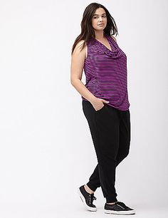 You'll love the loose, easy fit and fashion-forward details on Livi Active's striped tank. Flattering draped neckline and racer back keep the look on trend. lanebryant.com