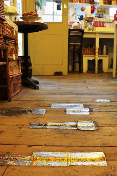Patching a wood floor, the old fashioned way--A. Gold, London shop (posted on Poppytalk)