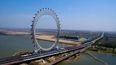 Ferris wheel: a Chinese attraction with 145 meters of height. Ferris wheel: a Chinese attraction with 145 meters of height. The peculiarity of this new creation is in its structure without radios, the Ferris wheel is based on two points on the surface. Another differentiating point is in its mesh structure... #wheel #NewCreation #StructureWithoutRadios #AbanTech #technology #Innovation #WheelOfFortune #MeshStructure #Architects #ColumnOfTheDragon #WiFiConnectivity #TV #China