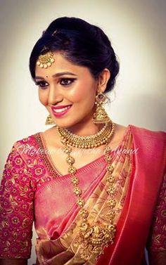South Indian bride. Gold Indian bridal jewelry.Temple jewelry. Jhumkis. Pink…