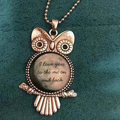 Owl Necklace Cute owl necklace with glass Cabochon pendant that says I love you to the moon and back. Chain is about 30 inches.metal is zinc alloy. Ball and chain necklace. Jewelry Necklaces