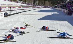 Winner, Norway's Marit Bjoergen (far left), and Sweden's Charlotte Kalla, Norway's Therese Johaug, Norway's Heidi Weng and Finland's Aino-Kaisa Saarinen collapse at the finish line