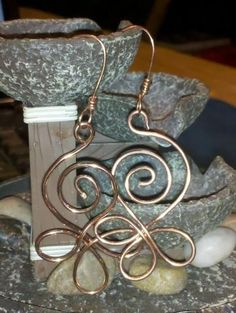 Very pretty copper swirl earrings from All Chained Up & No Where To Go.  I like the simplicity of all the swirls together