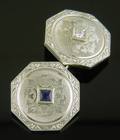 Bright blue sapphires and sparkling diamonds set amid finely engraved, intertwining foliage. Elegant scroll-and-volute borders in the early Art Deco taste decorate the edges. The twining vines around the gemstones appear to be ivy - a symbol of eternal fidelity and affection. Created by Krementz & Co. in 14kt gold, circa 1925.