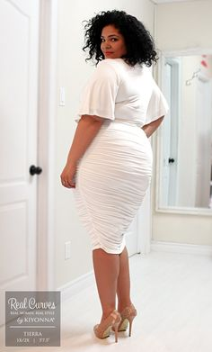 """Real Curve Cutie and model, Tierra (5'7.5"""" and a size 1x/2x) flatters every curve with beautiful ruching with our plus size Rumor Ruched Dress for a stylish Canadian boutique, SexyPlus Clothing.  Find your sexy dress at www.kiyonna.com.  #KiyonnaPlusYou  #MadeintheUSA"""