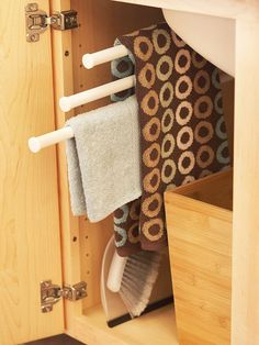 Store damp hand towels on convenient pullout racks beneath the sink. Similar to storage found in the kitchen, the pullouts keep towels out of sight when you don't need them but provide easy access when you do