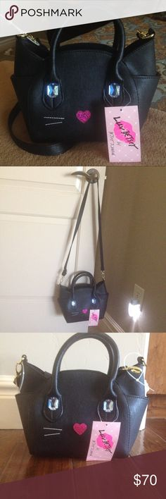 🔮 FreeBetseyNecklace🌙  Black Cat Purse🌙 Black cat handbag doubles as a crossbody with a detachable strap. Has blue jewel eyes and a pink sparkle nose. Buy at listed price and receive a Betsey Johnson NWT necklace. Only included if purchased at listed price. Offers will not receive the necklace. Betsey Johnson Bags Crossbody Bags