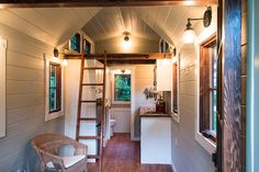 A 150 square feet tiny house on wheels in Guntersville, Alabama. Designed by Timbercraft Tiny Homes.