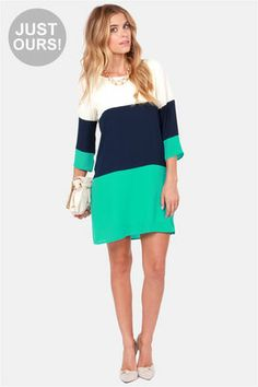 Check it out from Lulus.com! LuLu*s Exclusive! Nothing breaks through those cold-weather blues like a sun-kissed walk in the Citrus Grove Blue Color Block Shift Dress! Contrasting bands of ivory, navy blue, and teal sharpen up a shift bodice and three-quarter sleeves. Bateau neckline. Back keyhole has top button closure. Bodice is lined. Model is wearing a size small. 100�0Polyester. Hand Wash Cold. Made with Love in the U.S.A.