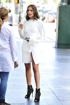 Flashing her assets: Olivia Culpo made sure all eyes were on her when she was spotted chatting to a friend in Hollywood on Monday in a very revealing little white dress