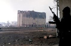 Chechen Fighter near ruins of Presidential Palace, Grozny, Chechnya, 1995