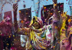 Indian widows at Holi Festival by Roberto Schmidt | Colours, women | India