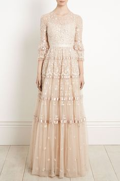 NEW to Bridal Autumn/Winter 17. The Roses Gown in Champagne Grey combines intricate embroidery with sparkling floral motifs. The tiered silhouette features a full voluminous skirt, with satin ribbon borders in between each tier for a fairytale silhouette. The flattering, semi sheer sleeves are fully embellished, and fall elegantly above the wrist. With a pearl essence thread and scalloped details, this embellished wedding dress epitomises timeless romance.