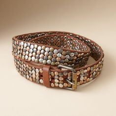 "STREET OF DREAMS BELT -- Vegetable-tanned leather, paved with shimmering studs of brass, copper, silver and nickel-colored metal to lend star quality to jeans, leading lady looks to sweaters and dresses. Made in The Netherlands. M (33-1/2""), L (37-1/2""). Approx. 1-1/2""W."