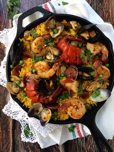 A healthy, EASY Spanish seafood paella recipe made with the freshest wild caught shrimp, lobster tails, mussels and clams. Plus just a little chicken andouille sausage for extra flavor. Easy Soup Recipes, Seafood Recipes, Salad Recipes, Chicken Recipes, Dinner Recipes, Seafood Meals, Skillet Recipes, Simple Recipes, Party Recipes