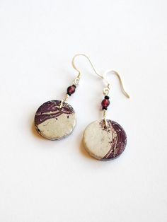 Purple and white boho earrings are made of handmade clay beads, glass beads, and nickel free earwires.