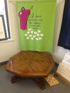 Empty prayer table -- we have banner behind with the Good Shepherd and sheep with the names of our baptized children on it