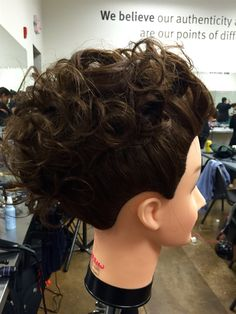 The marcel curls in an up-do.  In class assessment