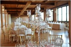 Candelabra centerpiece at Bridgeport Art Center. I like these minus the crystals hanging and I would alternate them w/flower centerpieces. maybe have a few mercury glass votives or petals at the base Candelabra Centerpiece, Flower Centerpieces, Centrepieces, Bridgeport Art Center, Event Planning, Wedding Planning, Giant Balloons, Wedding Flowers, Wedding Stuff