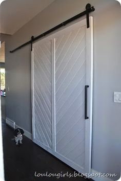How-To-Build-Your-Own-Chevron-Barn-Door - They pd. $250 just for hardware...better buy from Tractor supply, have it electrostatic-ally painted any color you like.