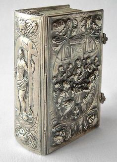 Silver bookbinding made by a Bavarian silversmith in the 17th century showing the last supper