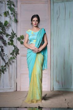 SR-SBYL-40708: Issa sky blue and sunshine yellow georgette and net saree to brighten the day.They can customize the colour size as per your requirement.To order 28 September 2017