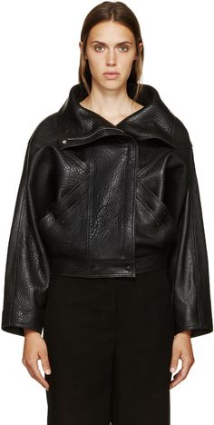 Grained leather jacket in black. Fold-down stand collar. Off-set zip closure. Layered welt pockets at waist with press-stud closure. Dolman sleeves. Fully lined. Tonal stitching.