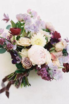 A bridal bouquet full of spring florals in lavender and purple hues. Photo: @daniellebaconphotography Purple Hues, Flower Arrangements, Wedding Planner, Fairy Tales, Wedding Flowers, Floral Wreath, Lavender, Bouquet, Bride