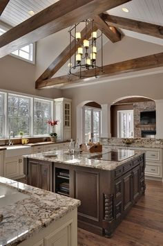 Love the colors of painted cabinets with the granite counter tops.