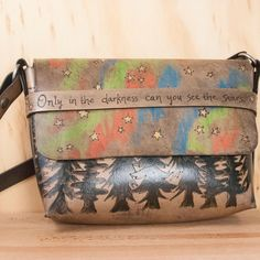The Stars Purse.  This little bag captures the comfort, awe and wonder of sleeping under the stars.  On the front closure strap it has the Martin Luther King Jr quote - only in the darkness can you see the Stars.  Handmade in Seattle.