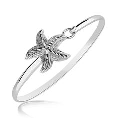 Update your Spring Jewelry.   Free shipping every day - be sure to check out our March promos.  Sterling Silver Starfish Motif Slim Bangle with Rhodium Plating - 74773-7 - Comes in sizes 7 or 8.
