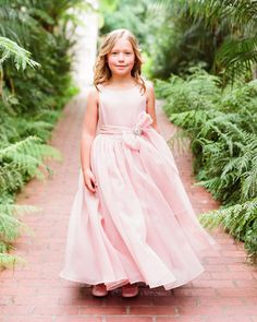 A billowing pink dress from Kirstie Kelly fits perfectly into a romantic color palette