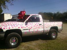 Surprise for #Valentine's Day - heart shaped post it notes all over a truck.